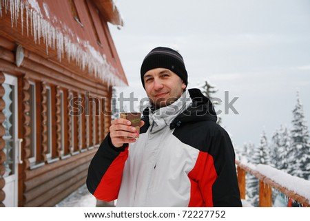 Portrait of young man of skier with glass of Mulled wine in hand, Carpathian Mountains, Dragobrat, Ukraine