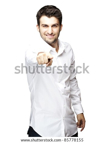 portrait of young man pointing with finger against a white background