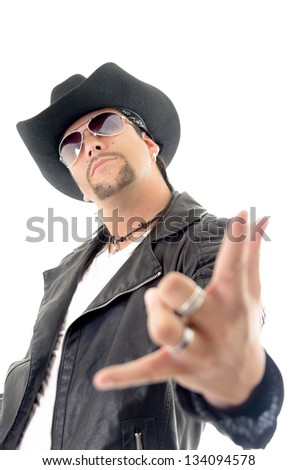 Portrait of young man showing you rock sign on white background