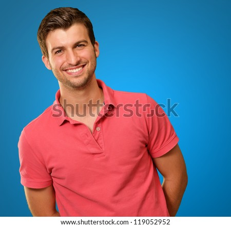 Portrait of young man smiling isolated on blue background
