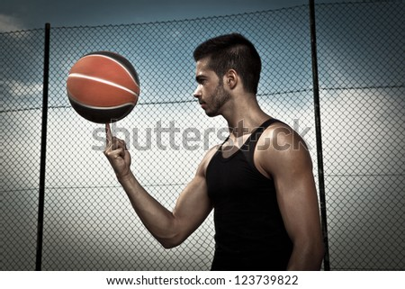 Portrait of young man street basket player