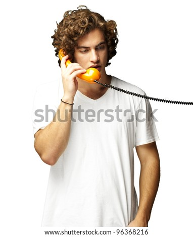 portrait of young man talking on a vintage telephone against a white background