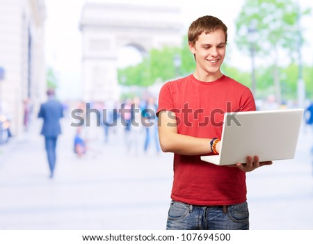 Portrait Of Young Man Using Laptop, Outdoor - stock photo