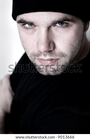 Portrait of young man wearing beanie - selective focus on the model's right eye.