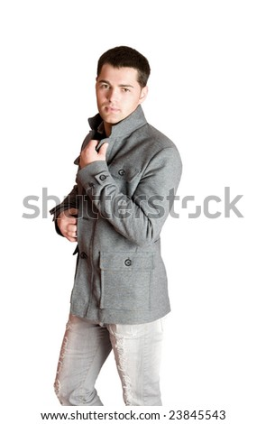 Portrait of Young man wearing coat isolated on white
