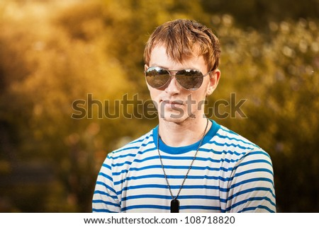 Portrait of young man wearing sunglasses outdoors
