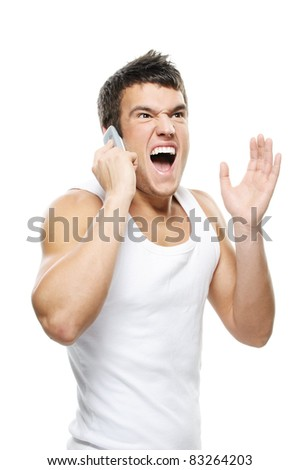 Portrait of young man wearing t-shirt, speaking on mobile phone and shouting against white background.