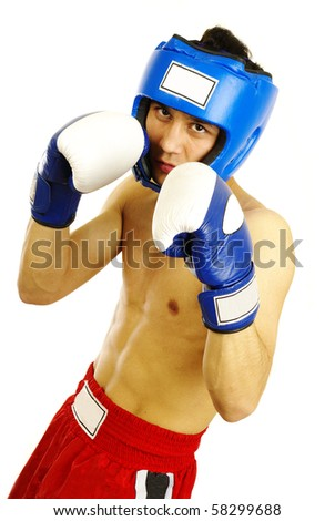 Portrait of young man with boxing helmet and gloves over white background
