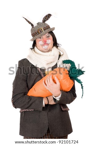 Portrait of young man with carrot dressed in a suit rabbit