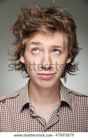 portrait of young man with displeased hair in shirt