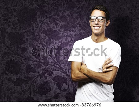 portrait of young man with glasses against a grunge background