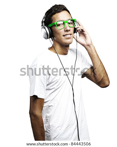portrait of young man with green glasses listening to music on a white background