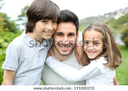 Portrait of young man with 2 kids