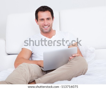 Portrait Of Young Man With Laptop, Indoors