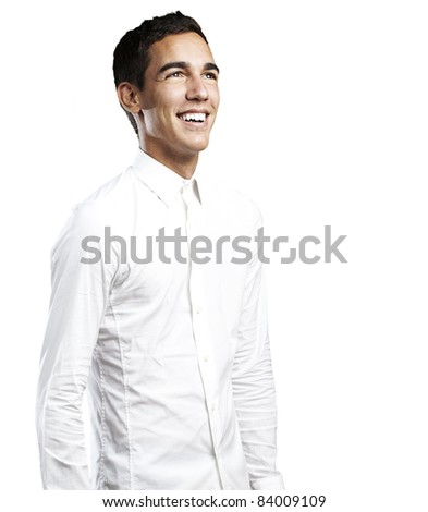 portrait of young man with white shirt smiling against a white background