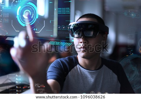 Portrait of young men with 3D virtual reality glasses hololens | Young student experiments virtual reality world in the lab
