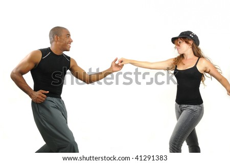 Portrait of young multiracial couple dancing isolated on white