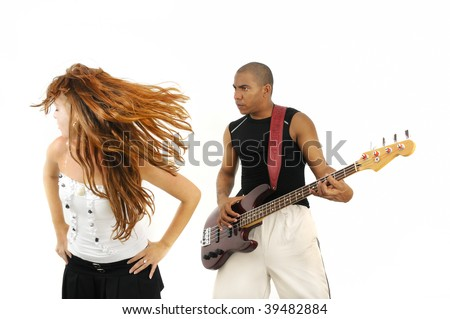 Portrait of young multiracial couple of young man playing bass guitar and girl dancing isolated - stock photo