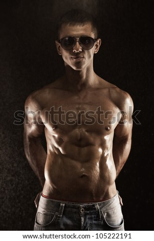 Portrait of young muscular man in studio