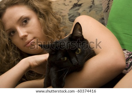 Portrait of young nasty woman with her cat