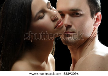 portrait of young people in love on a black background - stock photo
