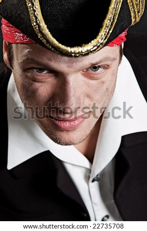 portrait of young pirate over dark background