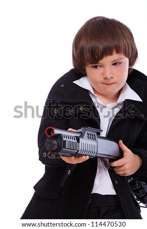 Portrait of young posing in studio with gun