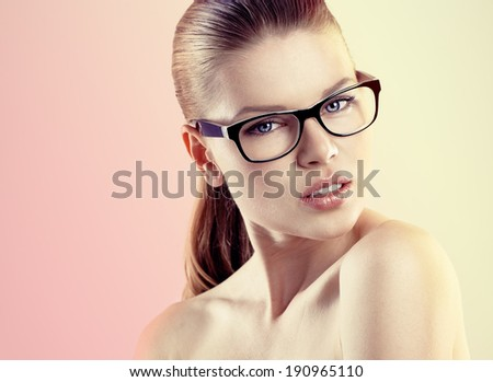 Portrait of young pretty female wearing stylish optical eyeglasses Beautiful Caucasian woman model in spectacles posing in studio