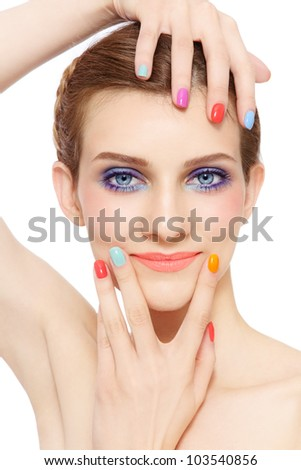 Portrait of young pretty smiling girl with bright make-up and colorful nail polish, on white background