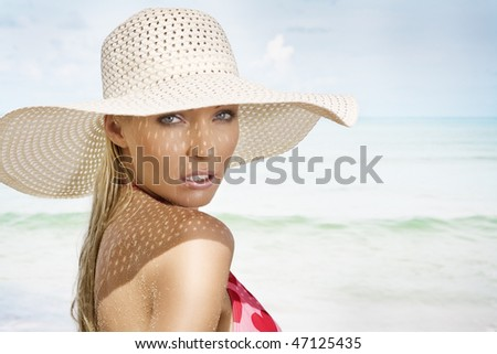 Portrait of young pretty woman in summer environment
