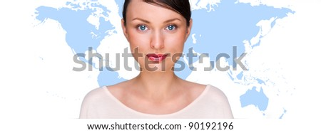 Portrait of young pretty woman looking at camera with map on background against white background