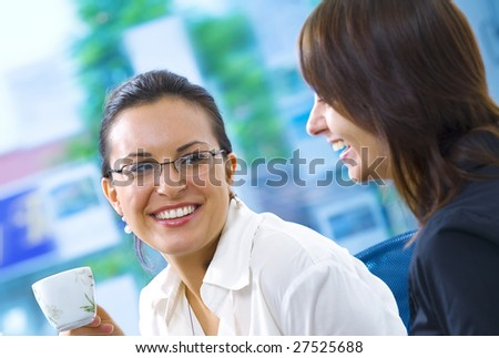 Portrait of young pretty women having coffee break in office environment