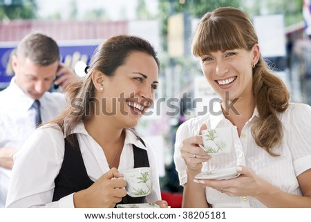 Portrait of young pretty women having coffee break in office environment - stock photo