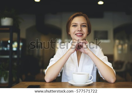Portrait of young professional administrative manager in trendy clothes of coffee shop starting day early in morning organizing and controlling working process and stuff motivating with good mood  stock photo