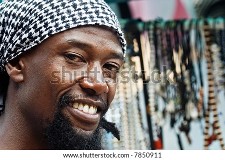portrait of young rasta man in the craft market