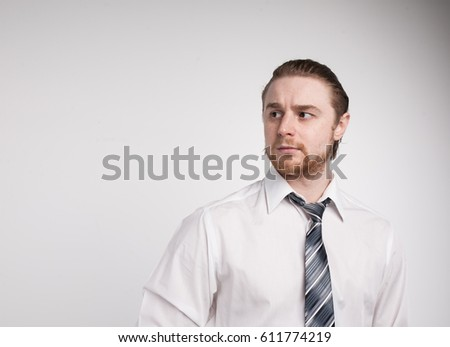 Portrait of young redhead man with beard white shirt and grey tie sunglasses isolated #611774219