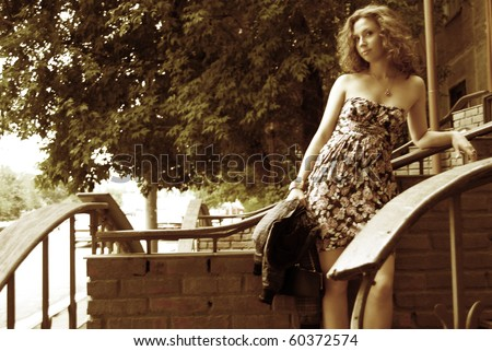 Portrait of young sad attractive woman outdoor