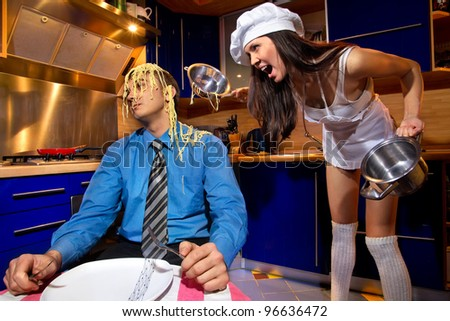 Portrait of  young sad falling out a couple (male, female) background of kitchen