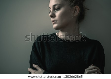 Portrait of young sad woman with anxiety disorder, anorexia ans loneliness concept