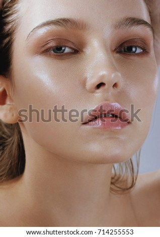 Portrait of young sensual woman with perfect healthy skin and nude makeup and long brunette hair #714255553