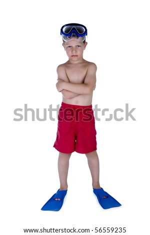 Portrait of young serious boy in swimsuit and snorkel gear, studio shot - stock photo