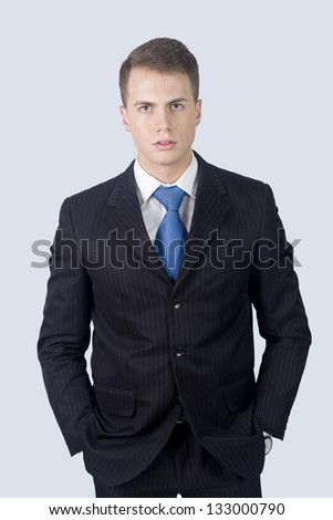 Portrait of young serious business man, isolated on white background