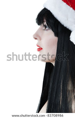 Portrait of young sexy female model in red santas cap on white background