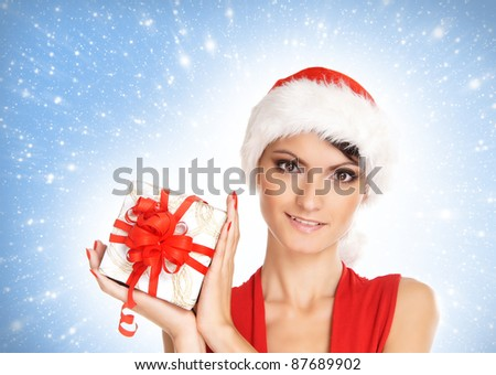 Portrait of young, sexy female Santa isolated on blue