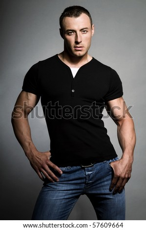 Portrait of young sexy man on grey background.