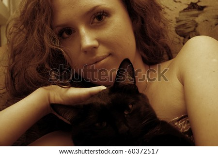 Portrait of young sexy woman with cat