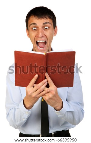 portrait of young shocked business man reading the book, isolated background