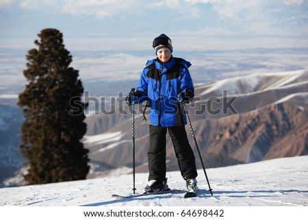 Portrait of young skier on ski slope