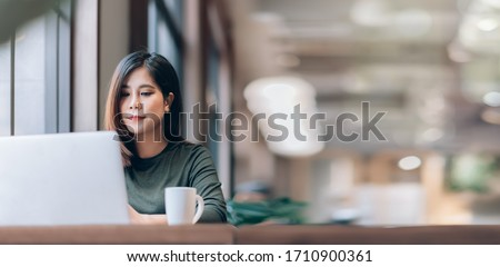 Portrait of Young Smart Asian Woman Freelance Online Working from Home with Laptop at Home Living Room in Coronavirus or Covid-19 Outbreak Situation - Healthcare and Social Distancing Concept