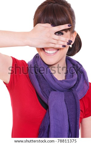 portrait of young smiley woman looking through her fingers. isolated on white background